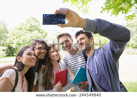 Happy students taking a selfie outside on campus at the university - stock photo