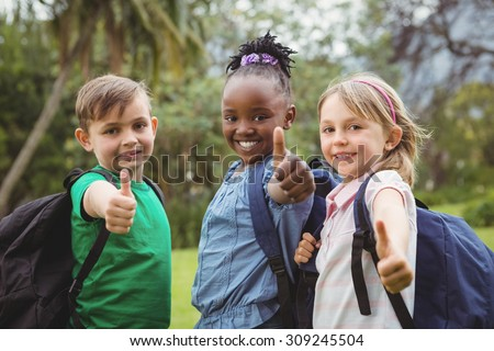 Happy Students wearing school bags on the elementary school grounds - stock photo