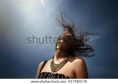 happy stylish woman hipster head in sky with windy  hair having fun on deck of a boat, summer travel concept - stock photo