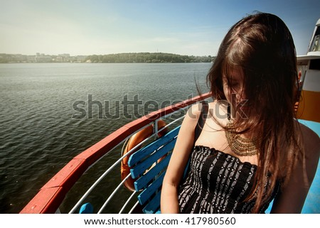 happy stylish woman hipster with windy  hair having fun on deck of a boat, summer travel concept, space for text - stock photo