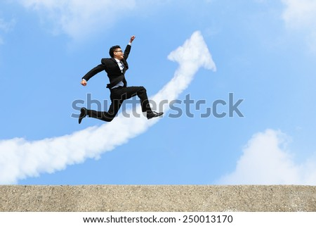 happy successful business man jump and run with arrow cloud and blue sky background, asian male - stock photo