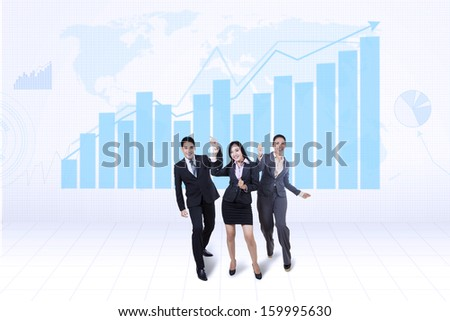 Happy successful business team with growth graph and world map background - stock photo