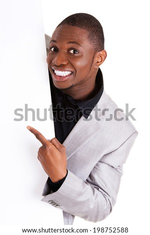 Happy successful businessman holding and showing blank board. - stock photo