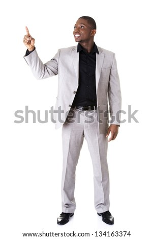 Happy successful businessman pointing on copy space. Isolated on white. - stock photo