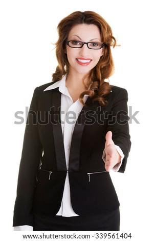 Happy successful businesswoman rady to hand shake. - stock photo