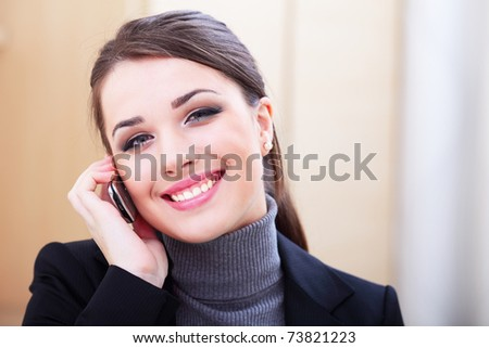 Happy successful businesswoman with cell phone