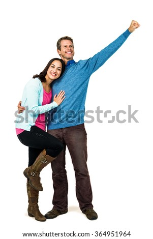 Happy successful man with girlfriend standing against white background