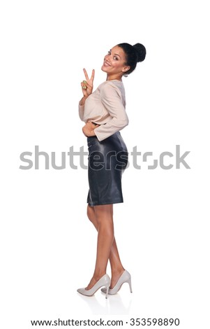 Happy successful mixed race caucasian - african american business woman in full lengh showing peace gesture and smiling at camera - stock photo