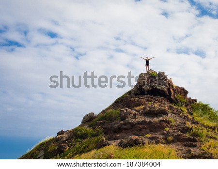 Happy successful sportswoman raising arms to the sky. Fitness athlete with arms up celebrating goals after sport exercising and working out outdoors. Copy space.  - stock photo
