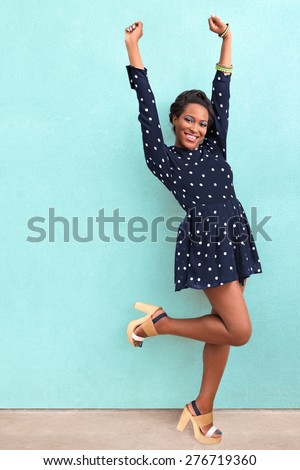 Happy summer African black woman in dress and sandals with copy space - stock photo