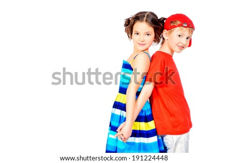 Happy summer children in bright clothes standing together. Isolated over white. - stock photo