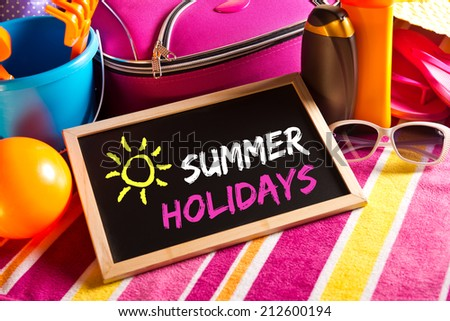 Happy summer holidays card with colorful text on blackboard. - stock photo