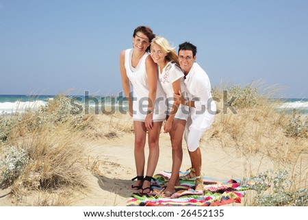 happy summer holidays - mother and daughters having fun on the beach - stock photo