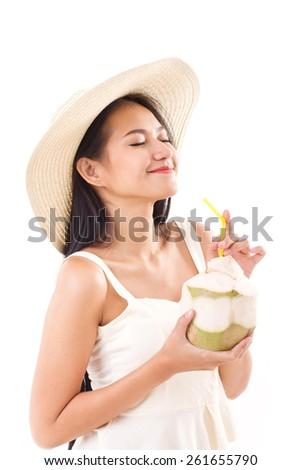 happy summer woman enjoying fresh coconut juice - stock photo