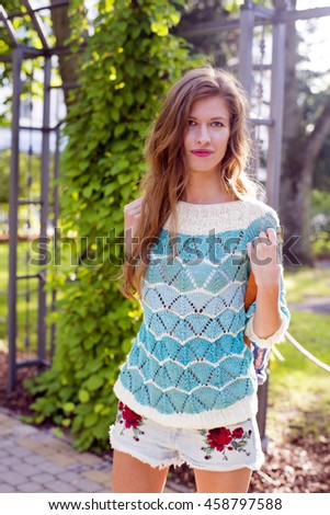 Happy summer woman in knitted sweater
