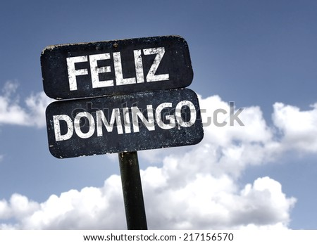 Happy Sunday (In Spanish/Portuguese) sign with clouds and sky background - stock photo