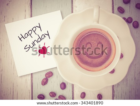 Happy Sunday with coffee cup on table   - stock photo