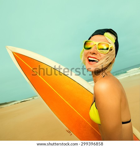 Happy Surfer Girl with stylish Surf board on the Beach. Surfing Time - stock photo