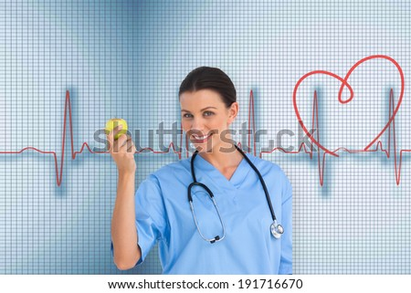 Happy surgeon holding an apple and smiling at camera against medical background with red ecg line - stock photo