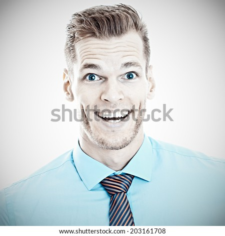 Happy Surprise - Portrait of a surprised young man with open mouth - stock photo