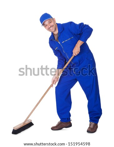 Happy Sweeper Cleaning Floor On White Background - stock photo