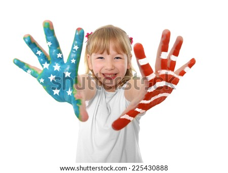 Happy sweet and cute little blonde hair girl showing hands painted with United States flag bars and stars white , blue , red colors smiling isolated on white background - stock photo