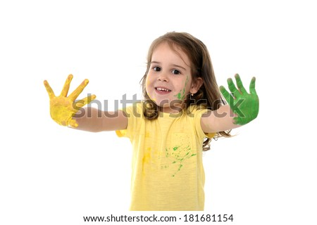 Happy Sweet little girl smiling and showing her painted hands in vibrant color yellow and green isolated on white background - stock photo