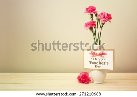 Happy Teachers Day message with pink carnations - stock photo