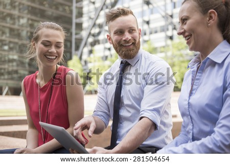 Happy team looking for perfect way for their business - stock photo