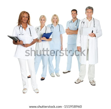 Happy team of doctors and surgeons standing isolated on white background - stock photo