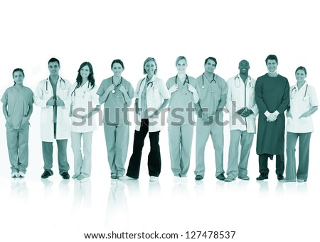 Happy team of doctors standing together in a line in a green tint on white background
