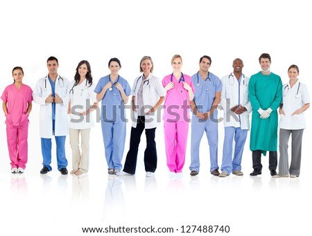 Happy team of doctors standing together in a line on a white background - stock photo