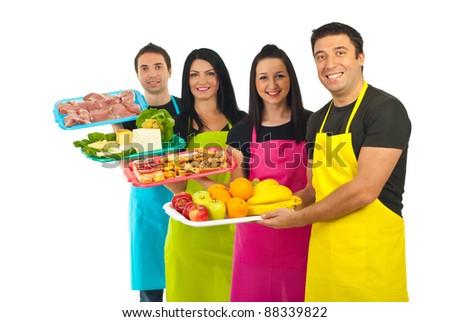 Happy team of four market workers holding fresh products isolated on white background - stock photo