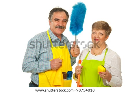 Happy team of mature cleaning people holding objects isolated on white background - stock photo