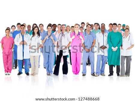 Happy team of smiling doctors standing together on a white background - stock photo
