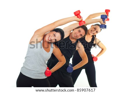 Happy team of three people workout with dumbbell and stretching - stock photo