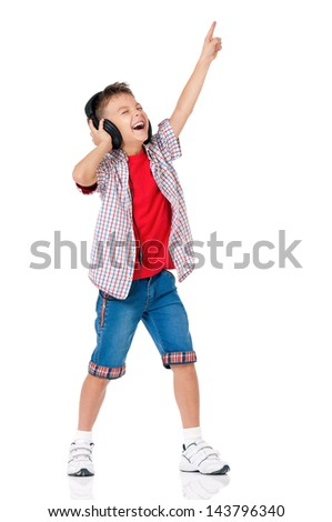 Happy teen boy with headphones, isolated on white background - stock photo