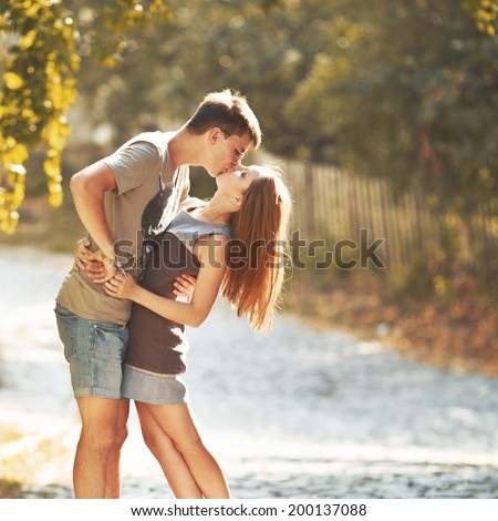 Happy teen couple embracing at street. Great relationships. - stock photo