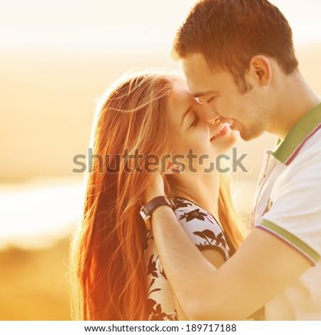 Happy teen couple embracing. Great relationships. - stock photo