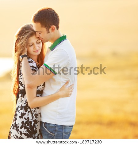 Happy teen couple embracing. Great relationships. - stock photo