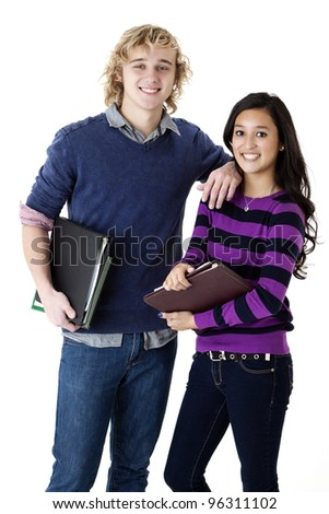 happy teen couple with school books - stock photo