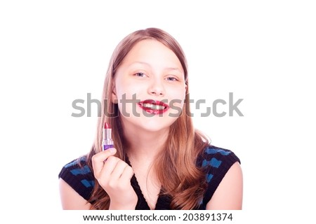 Happy teen girl holding lipstick and looking at the camera - stock photo