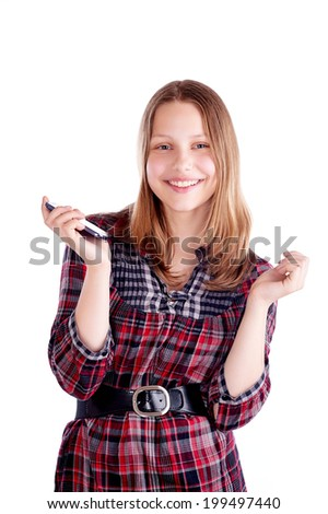 Happy teen girl laughing and use mobile phone, studio shot - stock photo