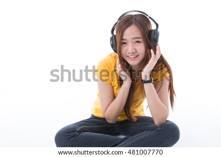 happy teen girl listening to music, full length, isolated on white