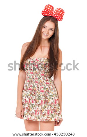 Happy teen girl portrait, isolated on white background. Young cheerful girl having fun. - stock photo