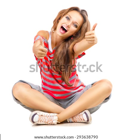 Happy Teen Girl showing Thumbs up isolated one white. Happy Teenager Model Girl Portrait - stock photo