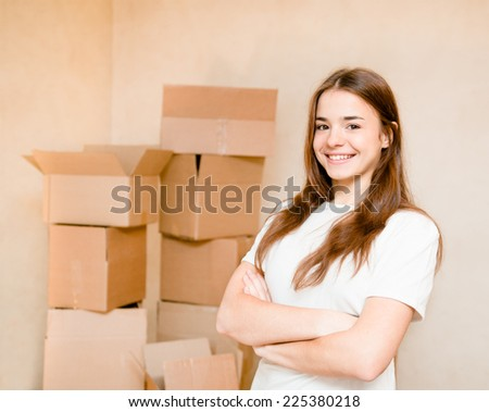 happy teen girl standing on a background of cardboard - stock photo