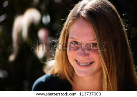 Happy teen girl with braces