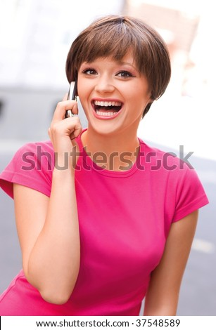 happy teen girl with mobile phone - stock photo