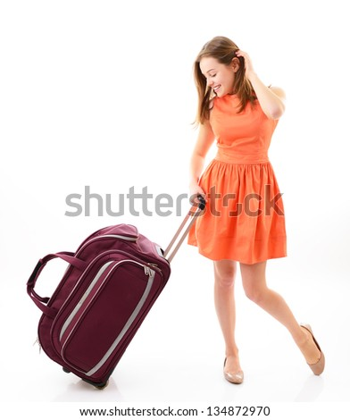 Happy teen girl with travel bag over white - stock photo